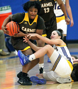 Candace H. Johnson-For Shaw Media Carmel's Ranya Jamison takes control of the ball against Johnsburg's Ava Interrante in the first quarter during the Class 3A sectional semifinal game at Johnsburg High School.