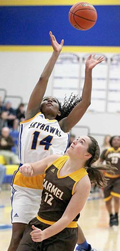 Candace H. Johnson-For Shaw Media Johnsburg's Danielle McCauley puts up for a shot over Carmel's Jennifer Giesey in the fourth quarter during the Class 3A sectional semifinal game at Johnsburg High School.