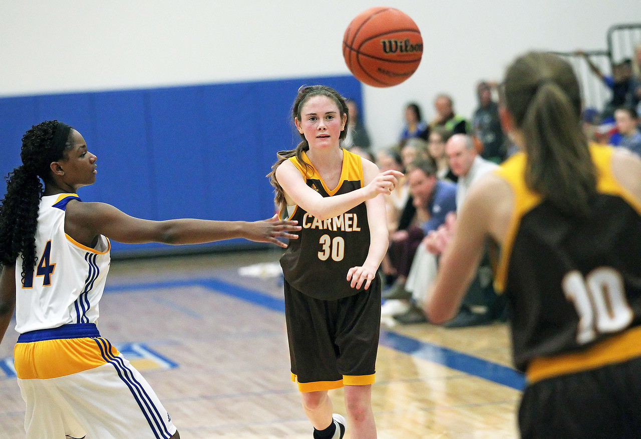 Candace H. Johnson-For Shaw Media Carmel's Caitlin Teehan (center) passes the ball to Ava Speer against Johnsburg's Danielle McCauley in the third quarter during the Class 3A sectional semifinal game at Johnsburg High School.