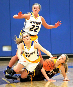 Candace H. Johnson-For Shaw Media Johnsburg's Taylor Piggott trips over Carmel's Katie Lach in the second quarter during the Class 3A sectional semifinal game at Johnsburg High School. Johnsburg's Heather Arden stood behind them.