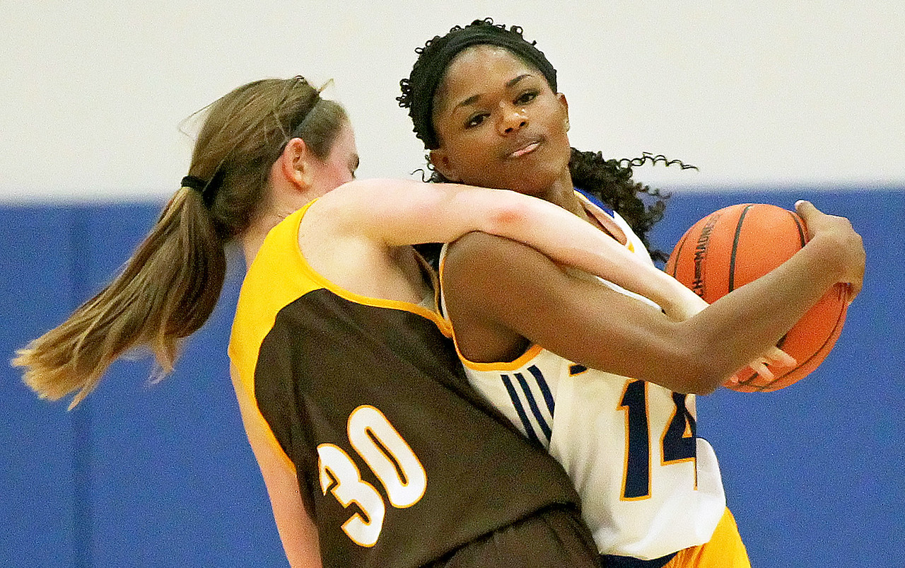 Candace H. Johnson-For Shaw Media Johnsburg's Danielle McCauley (on right) fights for the ball with Carmel's Caitlin Teehan in the third quarter during the Class 3A sectional semifinal game at Johnsburg High School.