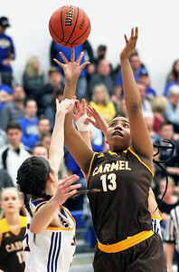 Candace H. Johnson-For Shaw Media Carmel's Daija Pruitt puts up a shot over Johnsburg's Kayla Stefka in the third quarter during the Class 3A sectional semifinal game at Johnsburg High School.