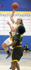 Candace H. Johnson-For Shaw Media Johnsburg's Taylor Piggott leaps up for a shot against Carmel's Ranya Jamison in the third quarter during the Class 3A sectional semifinal game at Johnsburg High School.