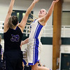 Wheaton North's Hannah Swider takes a shot during an IHSA class 4A sectional semifinal against Rolling Meadows at Glenbard West on Feb. 20. The Falcons lost 43-40 in overtime.