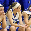 The Wheaton North bench show disapointment as their season nears an end during an IHSA class 4A sectional semifinal against Rolling Meadows at Glenbard West on Feb. 20. The Falcons lost 43-40 in overtime.