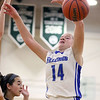 Wheaton North's Matti Zander looses the basketball after being fouled by Rolling Meadows' Alexa Davis during an IHSA class 4A sectional semifinal at Glenbard West on Feb. 20. The Falcons lost 43-40 in overtime.