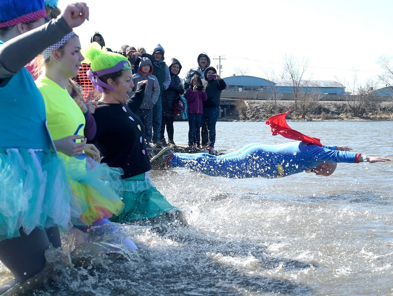 Kayla Wolf - For Shaw Media Members of the Woodstock D200 Trolls jump into Fox Lake Sunday, Feb. 26, 2017, for the10th annual Polar Plunge.