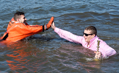 Kayla Wolf - For Shaw Media A member of the Fox Lake Police Department, right,  high-fives Sam Santiago of the Fox Lake Fire Department, left, at the 10th annual Polar Plunge in Fox Lake Sunday Feb. 26, 2017. The polar plunge is a fundraiser the Special Olympics of Illinois.