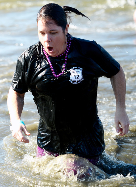 Kayla Wolf - For Shaw Media A member of the Route 12 Pub and Grill plunge group runs out of the water Sunday, Feb. 26, 2017, at the 10th annual Polar Plunge.