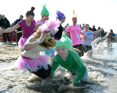 Kayla Wolf - For Shaw Media Members of the Woodstock D200 Trolls jump into Fox Lake Sunday, Feb. 26, 2017, for the 10th annual Polar Plunge in Fox Lake. Five schools participated in the 2017 Law Enforcement Torch Run Polar Plunge.