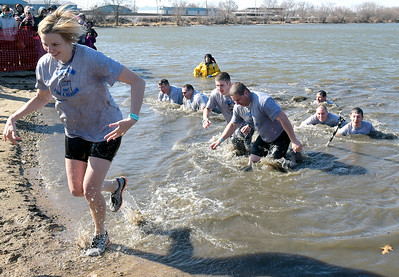 Kayla Wolf - For Shaw Media Members of the McHenry Police Department run out of the water Sunday, Feb. 26, 2017 at the 10th annual Polar Plunge in Fox Lake to benefit the Special Olympics of Illinois. This year Illinois held polar plunges at 22 locations around the state.