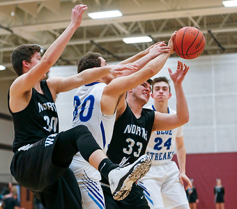 Michael Gardner (30) from Woodstock battles for a rebound between Joseph Haynes (left) and Zach Ramirez (33) from Woodstock North during the third quarter of their Class 3A regional game at Richmond-Burton High School on Monday, February 27, 2017 in Richmond. The Blue Streaks defeated the Thunder 56-44. John Konstantaras photo for the Northwest Herald