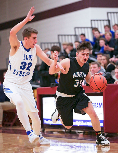 Vic Ortiz (31) from Woodstock North brings the ball cross court as Justin Leith (32) from Woodstock defends during the first quarter of their Class 3A regional game at Richmond-Burton High School on Monday, February 27, 2017 in Richmond. The Blue Streaks defeated the Thunder 56-44. John Konstantaras photo for the Northwest Herald