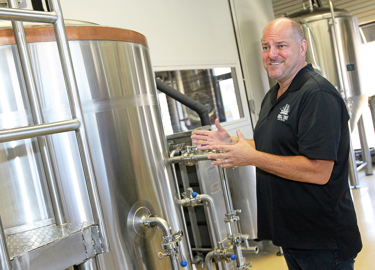 Candace H. Johnson-For Shaw Media Brewmaster Tim Kovac talks about making his specialty beers at Small Town Brewery in Wauconda.