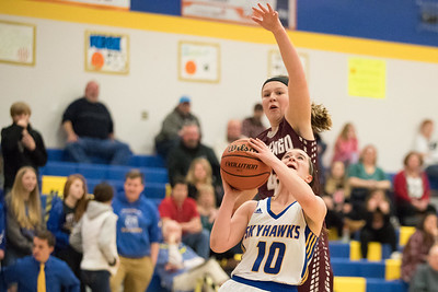 Whitney Rupp for Shaw MediaMarengo's Hannah Ritter attempts a block on Sarah Metze of Johnsburg at Johnsburg Wednesday, Jan. 31.