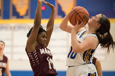 Whitney Rupp for Shaw MediaSarah Metze of Johnsburg prepares to shoot against Marengo's Jordan Parker in Johnsburg Wednesday, Jan. 31.