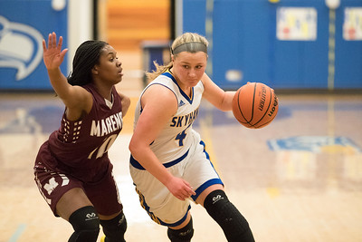 Whitney Rupp for Shaw MediaMarengo's Jordan Parker guards Megan Madsen of Johnsburg in a conference game at Johnsburg Wednesday, Jan. 31.