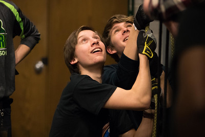 Whitney Rupp for Shaw MediaAaron Fater, 16, left, and Jake Modrzejewski, 14, work together to help lift a cast mate into the air during rehearsal for Peter Pan at Crystal Lake South High School Friday, Feb. 2.