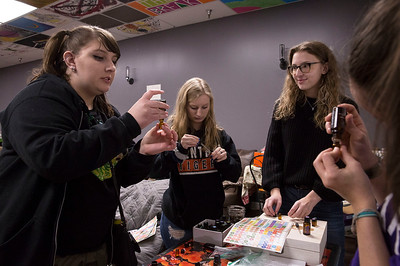 (L-R) Kaylee Gebhardt, McHenry, Destinee Belinsky, Crystal Lake, Zoe Foltman, Crystal Lake, and Rebecca Kebr, Crystal Lake, get samples of essential oils during an Estrogen Express meeting at the Break Teen Center on Saturday, February 3, 2018 in Crystal Lake, Illinois. John Konstantaras photo for Shaw Media
