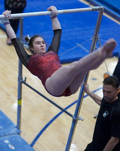 Praire Ridge's Macey Woodlock performs on the uneven parallel bars on Feb 7 at Hoffman Estates Sectional.