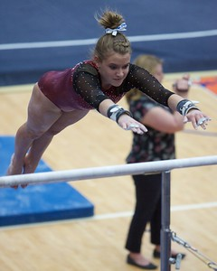Prarie Ridge's Clancy Raupp performs on the uneven parallel bars on Feb 7 at Hoffman Estates Sectional.