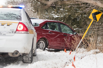 Whitney Rupp for Shaw MediaPersonnel from the McHenry County Sheriff's Office respond to a single vehicle crash the morning of Thursday, Feb. 8 on Crystal Springs Road near the intersection of Cherry Valley Road.