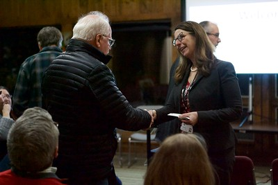 McHenry County's Conservation District Executive Director Elizabeth Kessler greets attendees on Feb 8 before the meeting held at Prarieview Educational Center in Crystal Lake concerning the farm to table operations on the grounds formerly known as Pichen Family Farm