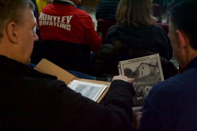 Attendees look at old pictures of Pichen Farm  on Feb 8 before the meeting held at Prarieview Educational Center in Crystal Lake concerning the farm to table operations on the grounds formerly known as Pichen Family Farm