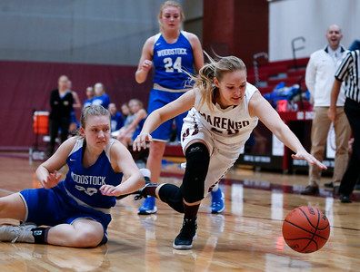 Erin Haeflinger (20) from Marengo chases down a loose ball as Amy Keyzer (30) from Woodstock watches during the second quarter of their game at Marengo High School on Thursday, February 8, 2018 in Marengo, Illinois. The Indians defeated the Blue Streaks 70-43. John Konstantaras photo for Shaw Media