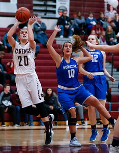 Erin Haeflinger (20) from Marengo shoots past Jessica Flynn (10) from Woodstock during the third quarter of their game at Marengo High School on Thursday, February 8, 2018 in Marengo, Illinois. The Indians defeated the Blue Streaks 70-43. John Konstantaras photo for Shaw Media