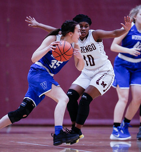 Jordan Parker (10) from Marengo defends Nichole Piquette (35) from Woodstock during the fourth quarter of their game at Marengo High School on Thursday, February 8, 2018 in Marengo, Illinois. The Indians defeated the Blue Streaks 70-43. John Konstantaras photo for Shaw Media
