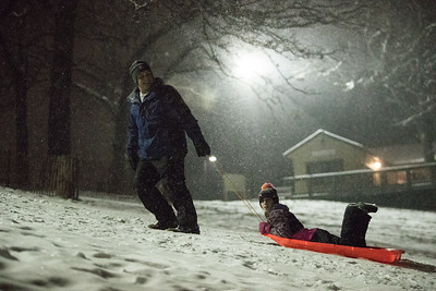 Whitney Rupp for Shaw Media Joe Farinella pulls Kennedy Burton up a sledding hill at Veteran Acres Park the night of Thursday, Feb. 8.
