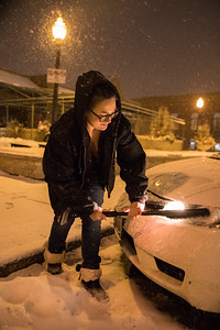 Whitney Rupp for Shaw Media Rebecca Kruk, Mundelein, clears snow off of her car in downtown Crystal Lake Thursday, Feb. 8.