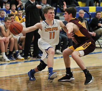 Candace H. Johnson-For Shaw Media Johnsburg's Alec Smith looks to pass against Richmond-Burton's Luke Uhwat in the fourth quarter at Johnsburg High School.