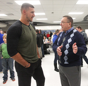 Candace H. Johnson-For Shaw Media C.J. Fiedorowicz, the Houston Texans' tight end, talks with Jim Meyers, of Huntley before the Athletic Hall of Fame Induction Ceremony at Johnsburg High School. Both were honorees.