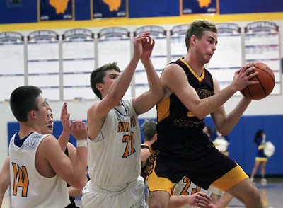 Candace H. Johnson-For Shaw Media Richmond-Burton's Kyle Townsend (on right) pulls down a rebound against Johnsburg's Zach Toussaint and Dylan Paprocki in the first quarter at Johnsburg High School.