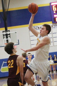 Candace H. Johnson-For Shaw Media Johnsburg's Mason Sobiesk leaps up for a shot against Richmond-Burton's Shane Byrne in the fourth quarter at Johnsburg High School.