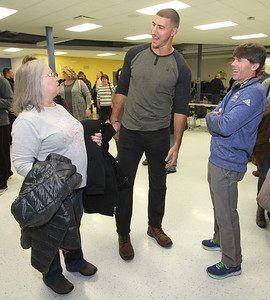Candace H. Johnson-For Shaw Media C.J. Fiedorowicz, the Houston Texans' tight end, (center) talks with Loraine Meyers, of Johnsburg and Chris Setzler, of Harvard, before being inducted into the Athletic Hall of Fame at Johnsburg High School. Setzler works at the high school and is the coach for cross country and track & field.