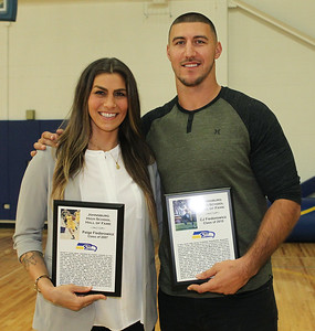 Candace H. Johnson-For Shaw Media Paige Fiedorowicz and her brother, C.J., hold their plaques after they had been inducted into the Athletic Hall of Fame at Johnsburg High School.