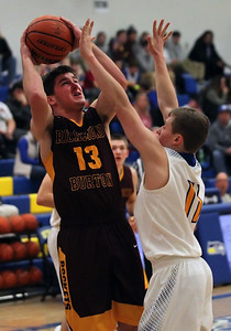 Candace H. Johnson-For Shaw Media Richmond-Burton's Luke Uhwat looks up for a shot against Johnsburg's Alec Smith in the second quarter at Johnsburg High School.