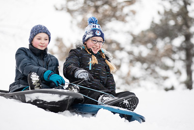 Whitney Rupp for Shaw Media Sage Berna, 11, left, and Clara Alt, 12, both of Crystal Lake, sled together at Veteran Acres Friday, Feb. 9.