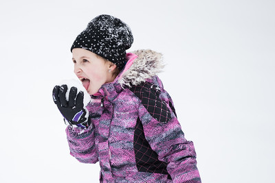 Whitney Rupp for Shaw Media Quinnlyn Buck, 8, Crystal Lake, samples the snow at Veteran Acres Park Friday, Feb. 9.