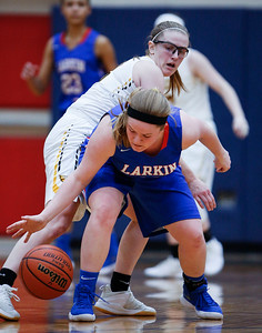 Kerri Healy (23) from Jacobs defends Haley Bohne (11) from Larkin in the fourth quarter during the Class 4A South Elgin Regional play-in game on Monday, February 12, 2018 in South Elgin, Illinois. The Royals defeated the Golden Eagles 39-44. John Konstantaras photo for Shaw Media