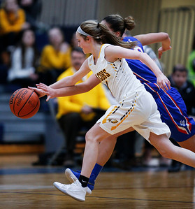 Courtney Durben (1) from Jacobs and Brianna Young (13) from Larkin chase a loose ball in the second quarter during the Class 4A South Elgin Regional play-in game on Monday, February 12, 2018 in South Elgin, Illinois. The Royals defeated the Golden Eagles 39-44. John Konstantaras photo for Shaw Media