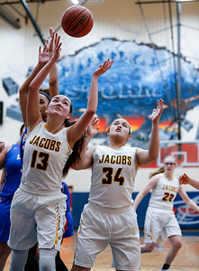 against Aleicia Valldejuli (13) and Kyra Cabusao (34) from Jacobs battle for a rebound in the fourth quarter of their game against Larkin during the Class 4A South Elgin Regional play-in game on Monday, February 12, 2018 in South Elgin, Illinois. The Royals defeated the Golden Eagles 39-44. John Konstantaras photo for Shaw Media