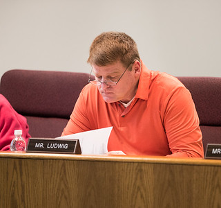 Whitney Rupp for Shaw Media School District 155 board member Ron Ludwig reviews a packet at a Feb. 12 Operations Committee Meeting.