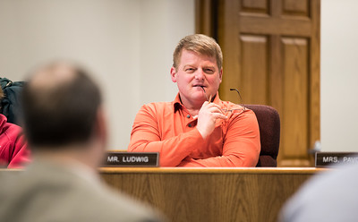 Whitney Rupp for Shaw Media Ron Ludwig, District 155 school board member, listens to a speaker at a meeting Feb. 12.