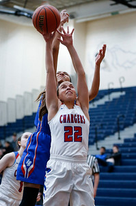 Anna Kieltyka (22) from Dundee-Crown reaches for a rebound in front of Aaliyah Dixon (23) from Larkin in the first quarter of their Class 4A South Elgin Regional game on Tuesday, February 13, 2018 in South Elgin, Illinois. The Chargers defeated the Royals 55-31. John Konstantaras photo for Shaw Media