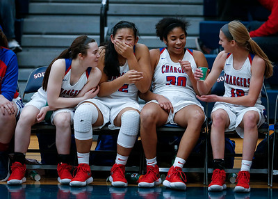 (L-R) Payton Schmidt (1), Gianine Boado (32), Alyssa Crenshaw (30) and Katelyn Skibinski (10) from Dundee-Crown take the bench in the fourth quarter of their Class 4A South Elgin Regional game against Larkin on Tuesday, February 13, 2018 in South Elgin, Illinois. The Chargers defeated the Royals 55-31. John Konstantaras photo for Shaw Media