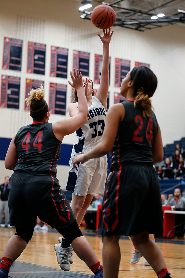 Ally Raupp (33) from Cary-Grove scores a basket over Miah Galvin (44) and Alexis Roberts (24) from South Elgin in the fourth quarter of their Class 4A South Elgin Regional game on Tuesday, February 13, 2018 in South Elgin, Illinois. The Trojans defeated the Storm 69-37. John Konstantaras photo for Shaw Media